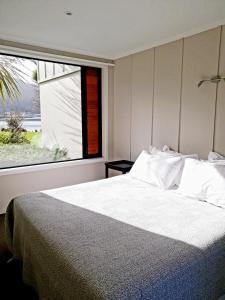 Säng eller sängar i ett rum på Braxmere