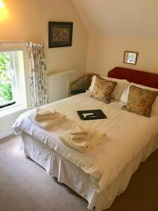 A bed or beds in a room at The Old Farmhouse
