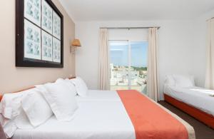 A bed or beds in a room at UR Portofino