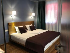 Кровать или кровати в номере Elle Boutique Hotel
