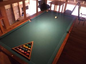 A billiards table at Afeto Pousada