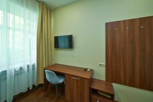 Телевизор и/или развлекательный центр в Отель Фортон