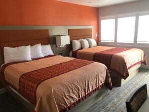 A bed or beds in a room at Presidio Parkway Inn