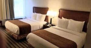 A bed or beds in a room at Best Western North Roanoke