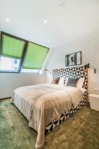 Ein Bett oder Betten in einem Zimmer der Unterkunft Luxury Residence near Parlament in @YourVienna