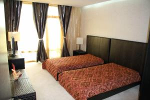 A bed or beds in a room at Garden of Eden Complex