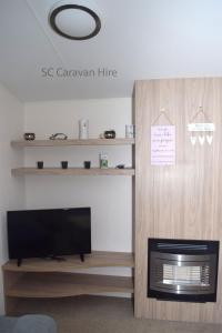A television and/or entertainment centre at Deluxe Seton Sands Caravan Hire