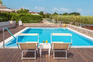 The swimming pool at or near Hotel Vila Rova