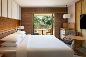 A bed or beds in a room at Hyatt Regency Bali