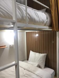 A bed or beds in a room at Naga Hostel & Café