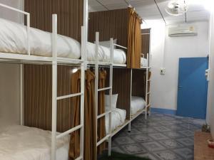 A bunk bed or bunk beds in a room at Naga Hostel & Café