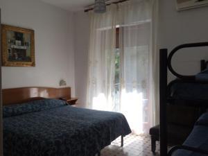 Letto o letti in una camera di Hotel Cavour