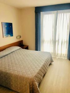 Letto o letti in una camera di Hotel Gallia
