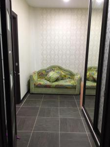 A bed or beds in a room at Baikal Apartments