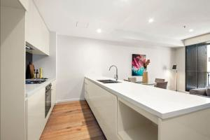A kitchen or kitchenette at Watch the City from the Balcony at a Fresh Urban Getaway