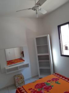 Cama ou camas em um quarto em Apartamento Douglas Buzzo