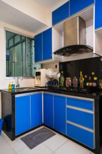 A kitchen or kitchenette at 'A'ffordable Spacius Apartment@Penang