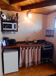 Una cocina o kitchenette en Cabañas Alechen