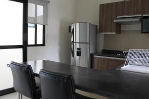 A kitchen or kitchenette at Suits Murato