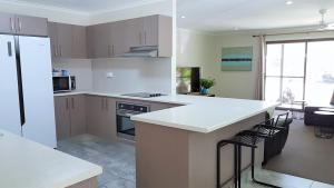 A kitchen or kitchenette at Noosa North Shore Retreat