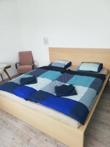 Postel nebo postele na pokoji v ubytování Apartmány pod Divadlem