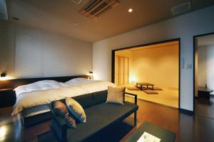 A bed or beds in a room at AMANE resort SEIKAI