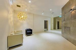 A television and/or entertainment center at Wyndel Apartments North Sydney - Harbour Watch