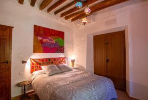 Cama o camas de una habitación en Cortijo La Caseria del Carmen