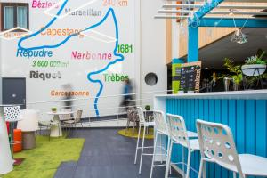 Ein Restaurant oder anderes Speiselokal in der Unterkunft Ibis Styles Toulouse Labège