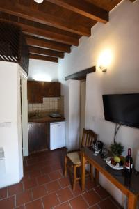A kitchen or kitchenette at Enipnion Apartments