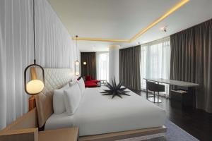 A bed or beds in a room at W London