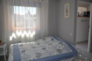 Łóżko lub łóżka w pokoju w obiekcie Pendrowka