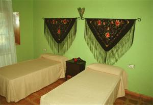 Cama o camas de una habitación en Casa Rural Puria