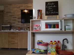 Küche/Küchenzeile in der Unterkunft Hotel Garni Haus Sonneneck