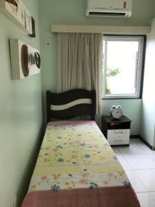 A bed or beds in a room at Casa na Barra de São Miguel com diária de Lancha e Cozinheira/arrumadeira