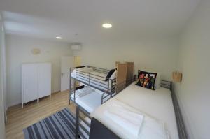 Uma ou mais camas em beliche num quarto em Hostel Douro Backpackers