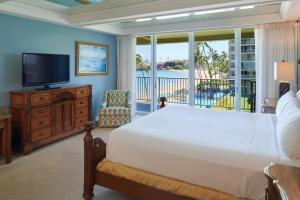 A bed or beds in a room at Aston at The Whaler on Kaanapali Beach