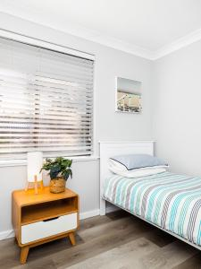 A bed or beds in a room at Myley's Flat