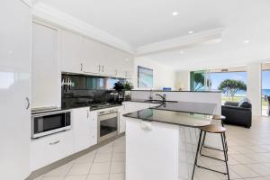 A kitchen or kitchenette at Aqua Solai Unit 1