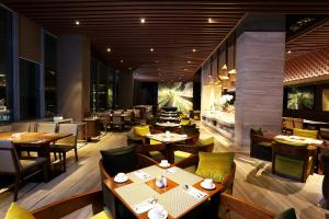 A restaurant or other place to eat at AONE Hotel