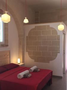 Letto o letti in una camera di Feudo d'Arneo