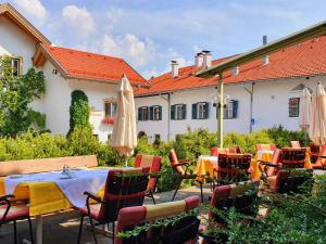 "A restaurant or other place to eat at Landgasthof ""Wilder Mann"""