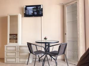 Телевизор и/или развлекательный центр в Mini-hotel Divnomorskiy