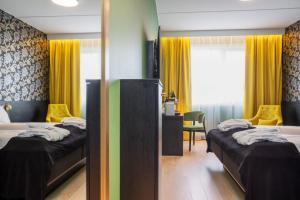 Ein Bett oder Betten in einem Zimmer der Unterkunft Thon Hotel Kirkenes