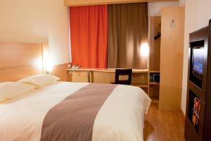 Кровать или кровати в номере IBIS Самара