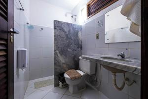 Um banheiro em Pousada Villa do Sol