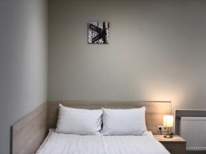 A bed or beds in a room at New City Inn