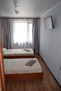 Кровать или кровати в номере Солнечная Дача