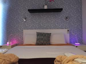 A bed or beds in a room at Rainbow Golf Bungalows, Gay Men-only Resort