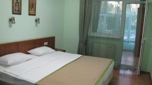 Кровать или кровати в номере Олеся Отель